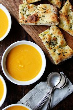 This butternut squash soup comes together in a flash and couldn't taste more like fall, the fragrant herbs so nicely complementing the squash and the subtle sweetness of the apple, the tangy sour cream balancing it all out. I've been serving it with flatbread topped with olive oil, sea salt, and minced sage and rosemary, two of butternut squash's best pals.