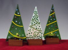 These delicate Christmas Tree luminaries are the perfect touch to your Christmas decor. Each luminary is unique, no two are alike and are sold individually. I created these luminaries in my studio from precisely cut glass. The bases are hand made from cherry wood to fit the glass