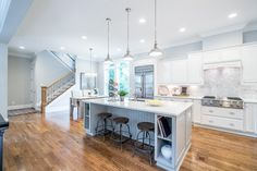 David Weekley Homes Raleigh Kitchen-large islands, whites and grays