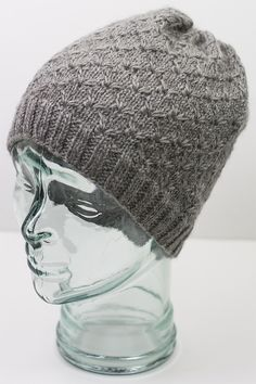 Free Knitting Pattern for Broderie Hat - This slouchy beanie uses an 8 row repeat Broderie Anglaise stitch pattern, created by drawing additional loops through stitches two rows below to make flower shapes. DK weight yarn. Designed by Cheryl Beckerich for Cascade Yarns