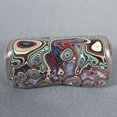 This stuff is cool. Fordite. Manmade, from paint build-up at the Detroit car factories back in the day before current technology. Limited and desirable...