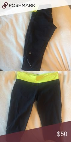 Size 8 running crops Black running crops with a black chevron print on the front (Very hard to see the chevron pattern) lime green band with secret pocket in the back. There is a small ruffle down the leg. These are training crops, so they are compression crops. Lululemon called these the marathon crop I believe. They are in fantastic condition I bought them as a gift and never gave them to the person lululemon athletica Pants Skinny