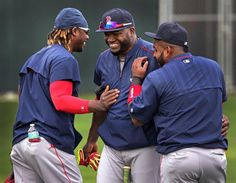 Fort Myers, FL - 02/27/15 - The three amigos Boston Red Sox outfielder Hanley Ramirez, Red Sox designated hitter David Ortiz, and Red Sox third baseman Pablo Sandoval share a laugh during the morning stretching. Red Sox Spring Training. (Barry Chin/Globe Staff), Section: Sports, Reporter: Peter Abraham, Topic: 28Red Sox, LOID: 8.0.2826364469.