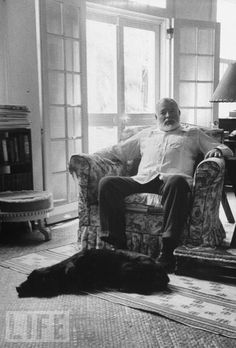 Ernest Hemingway and his dog; date, photographer and dog's name unknown.  I always thought he was a cat guy.  Via Dog Art Today.