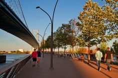 Adding to Philadelphia's amazing outdoor spaces, the new Race Street Pier on the Delaware River Waterfront is a relaxing respite in the heart of the city.  Located in the shadow of the Benjamin Franklin Bridge, the Pier features two-levels for riverside recreation. The upper terrace, dubbed the grand sky promenade, rises 12-feet towards the bridge and is paved with Trex, a sustainable, synthetic decking material made out of reclaimed plastic and wood. The promenade is connected to the lower…