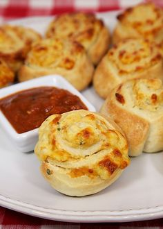 Cheesy Garlic Pinwheels - garlic seasoning, cream cheese, mozzarella baked in pizza dough - I could eat the whole batch! Great as a side with pasta or as an appetizer with warm sauce.: