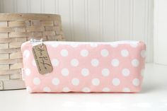 Here is a cute pencil case made of a lovely pink and white polka dot cotton print. Use it as change purse or to stow pens or pencils. Pattern placement