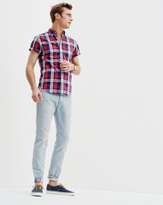 J.Crew men's short-sleeve lightweight cotton shirt in red plaid, 484 jean in Chapman wash and unisex Vans® for J.Crew washed canvas authentic sneakers.