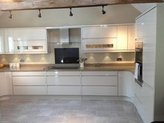 Another stylish Remo handleless kitchen in Beige by Second Nature specialist Concept Kitchens - http://www.sncollection.co.uk/real-kitchens/real-kitchen-projects/remo-beige-concept-kitchens.html