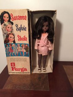 discoloration of the vinyl.....  FURGA VERY RARE VINTAGE SUSANNA BLACK DOLL WITH ORIGINAL BOX AND CLOTHES #Dolls