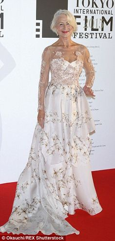 Show-stopper: The white satin number was covered in a pretty blossom print while the curve...