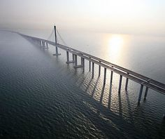 "World's Longest Bridges: Jiaozhou Bay Connection Project  Guinness had to create a whole new category for the engineering excess of this Shandong province roadway-sea bridge project after the 23.87-mile Lake Pontchartrain Causeway challenged its ""world's longest"" claim—officials took the aggregate length instead"