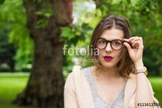 Young female looking shocked in glasses