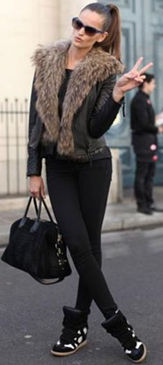 The camera caught Sherri on her way  to the office in casual clothes and fur collar sweater...