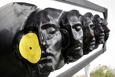 vinyl records melted over molds to make faces