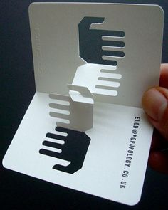 3d business card. Be as creative as you can with your business cards! At www.cardsmadeeasy.com will print them for you :)