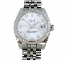 Rolex Oyster Perpetual Midsize Stainless Watch  Rolex Oyster Perpetual Midsize 31mm Stainless Steel Datejust Wrist Watch. Refernce # 178274  (2008 model)  Gray diamond dial with fluted Bezel, quick set motion.  Includes box, papers, and exta links.    One year guarantee on the movement!   Retails for $9,200.00 Item Number: WOO309