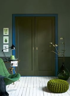 grey-green walls with blue features...