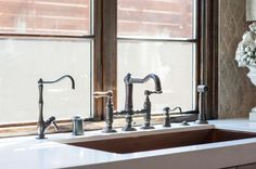 """Ludo cared the most about the look and design of the sink, which models a trough. The copper-lined sink was a challenge for Capo, because the copper would've meant a melange of metals. According to Ludo, """"in Europe, we combine different things. You Americans, everything is matching."""" ROHL Stainless Copper Kitchen Sink paired with Italian Country Kitchen Faucet in Tuscan Brass Finish. Designed by Ginny Capo. www.rohlhome.com"""
