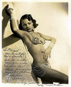 "Sahji     (aka. Madeleine Jackson)  Beautiful vintage 30's-era promo photo of Ms. Jackson, who was a Feature dancer at NYC's famed 'Cotton Club' nightspot from 1933 to 1939.. She personalized the photo to a fellow dancer: ""To Margot — You are tops as a dancer. And as a lady you are even higher. Best Wishes for your present & future happiness  — Sincerely,  Madeleine ""Sahji"" Jackson "".."