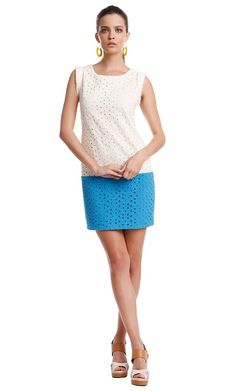 An update on the basic white dress, the Colorblock Eyelet Dress offers that pop of color every...