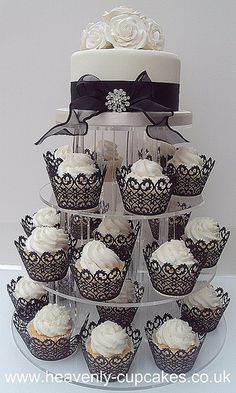 I love this idea in lieu of a large and elaborate wedding cake.     Black & White Wedding Cupcake Tower- Nottingham by Heavenly-Cupcakes.