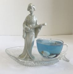 Lavender Scented Seascape Gel Candle in Glass Cup Resting on Unique Fish Plate with Geisha