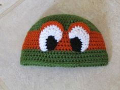 Crochet Fighting Tortoises Masked Hat (not a free pattern but I think I can figure it out...)