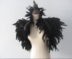 These feather collars or capelets have 2 layers , one turned upwards to make the high collar and 1 turned downwards.  Ties at the front with a satin ribbon. you can take the ribbons under the arms and tie in the back it makes fabulous shoulder wrap shrug with huge wing-like shoulders Halloween Party Costume Materials: feathers, lace , stain ribbons