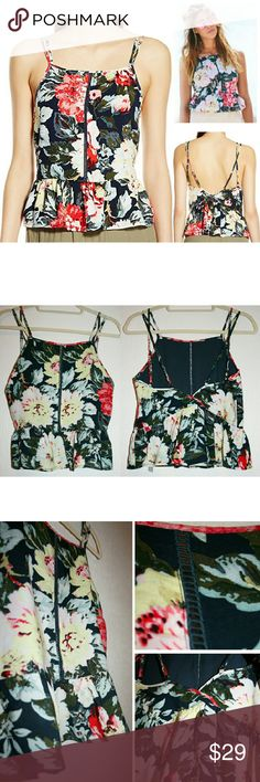 S,L MINKPINK Tropical Floral Print Peplum Top NWT This gorgeous strappy floral tank is so fashionable and fun! It features a ladder-stitched inset down the front, double criss-crossed adjustable straps, and a peplum waist. I love the peplum because it really makes your waist look extra tiny and accentuates an hourglass shape! The on-trend, super pretty tropical floral design is on a navy background. The fabric is 100% viscose. Happy to provide measurements upon request! MINKPINK Tops Tank…