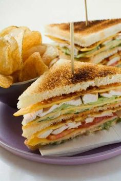 Club sandwich, American chicken and bacon sandwich, It is speculated that the club sandwich — with its layers of chicken, tomatoes and bacon — was originally made at the Saratoga Club House in Saratoga Springs, New York, the same place that invented potato chips. The original version had only two pieces of bread