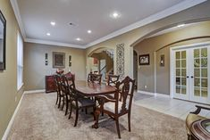 23502 Starbridge Lake Ln Richmond, TX 77407: Photo Currently, the formal living room (12'x12') is used to make an oversized dining room. Neutral tones, double crown molding, recessed lighting, and double arch way entries tie this space together.