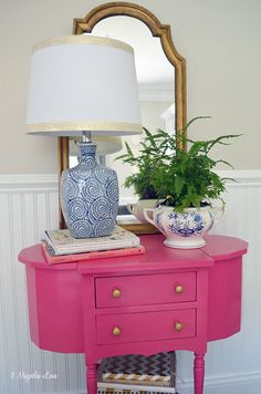 If you want to add a brightly colored piece of furniture in a room, start small.  This petite thrift store table got a coat of bright pink paint (and gold knobs for fun) and is perfect for spring.  Classic blues and whites are on-point accent colors--the HomeGoods lamp and vintage soup tureen/fern planter are a great contrast to the pink.  If your taste changes as often as the seasons, then a smaller piece is easy to move or even refinish when the times comes.  {Sponsored pin}