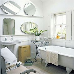 roll top bath & vintage mirrors Nice floor and panelling too