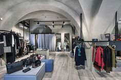 The atmosphere is soft and informal with the use of tactile finishes and lighting to bring out the clothing and creating a very comfortable and elegant setting with sobriety. store design » Retail Design Blog