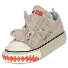 The Converse Toddler Chuck Taylor - Shark - Simple Slip On Shoes have all the characteristics of a shark. The shoes have shark eyes, scales, fins and you can't forget the jaws. I JUST BOUGHT THESE FOR PJ!! ♥