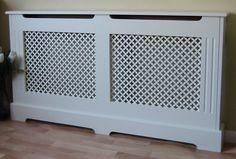 Perfect white chic cover for the lounge radiator. Also partners up as a shelf for displaying picture frames, candles and cute objects.