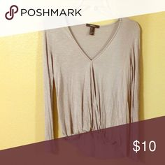 Casual long sleeve Light material. Super soft. Opening in the front that is held together only at the end of the v neck. Has a wrap design Forever 21 Tops Blouses