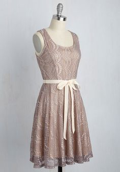 As part of the supporting cast for this celebration of nuptials, you simply can't wait to slip into this lavender lace dress for the rehearsal dinner. It's undeniable that romance is in the air - and in the details of your darling A-line frock as well, complete with a peach ribbon sash, a scoop neck, and a grace that shines!