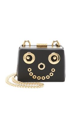 Metal accents form a bold smiley face on this structured, leather-covered Boutique Moschino bag.  Boutique Moschino Smiley Face Cross Body Bag