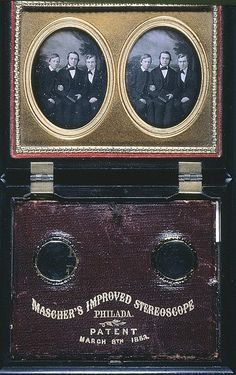 """""""A pair of stereo daguerreotypes of three young men is housed in a thermal plastic Masher's Improved Stereoscope with an 1853 patent. The lenses swing out to allow the image to be seen in 3D."""""""