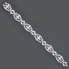 AN ART DECO DIAMOND BRACELET   The buckle-shaped links set with circular-cut diamonds, circa 1930, 18.0 cm long