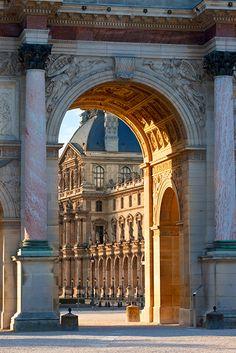 Arc de Triomphe du Carrousel with Musee de Louvre beyond, Paris France