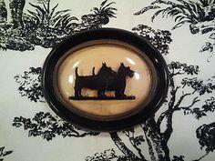 Vintage Silhouette Reverse Painted Scottie Dog Picture via Ebay.
