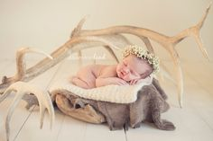 smiling newborn baby with elk antlers, fur, and baby's breath halo. Summerland Photography Nine Day Old Baby V : Kennewick West Richland Newborn Photography