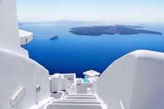 What an amazing view and a great job of matching architecture to the surroundings in Santorini, Greece