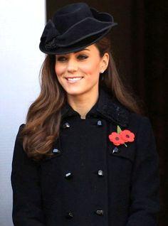 hats! i love how classy she always looks!