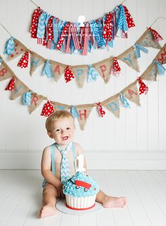 'Mom made these super cute banners and it was just perfect with his red wagon themed party and cake!'