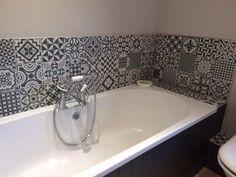 Waxman Ceramics' Rustic Heritage in black to create a monochrome bathroom feature/