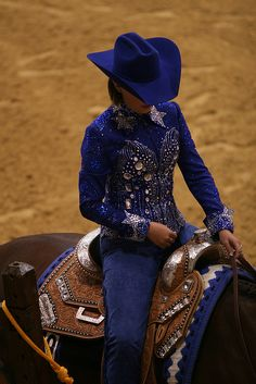 Blue hat, blue jacket, blue chaps, blue blanket.<3